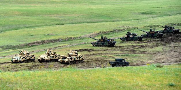 US Bradley infantry fighting vehicles and M1A2 Abrams tanks are seen during the Noble Partner 2016 joint...