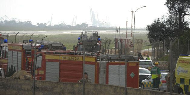 Emergency workers are seen at the site of the wreckage of a small twin engined plane which crashed shortly...