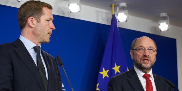 Wallonia's socialist government head Paul Magnette (L) and European Parliament President Martin Schulz...