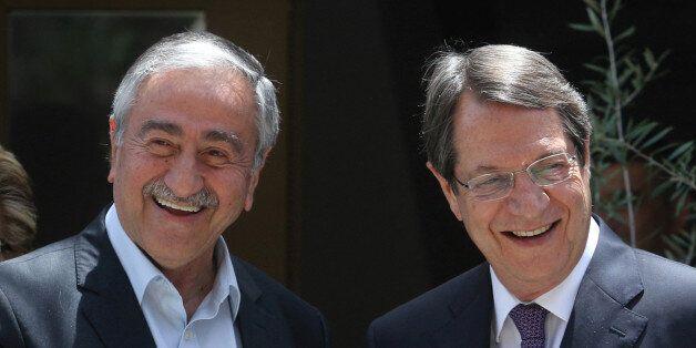 Greek Cypriot leader and Cyprus President Nicos Anastasiades (R) and Turkish Cypriot leader Mustafa Akinci...