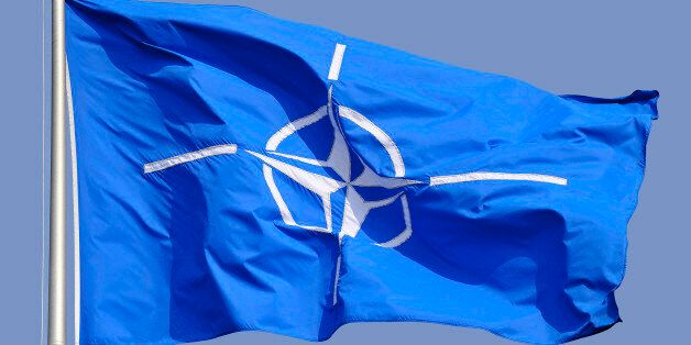 Flag of the North Atlantic Treaty Organization in front of the headquarters in