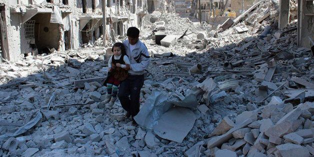 FILE -- In This April 21, 2014, file photo, provided by the anti-government activist group Aleppo Media...