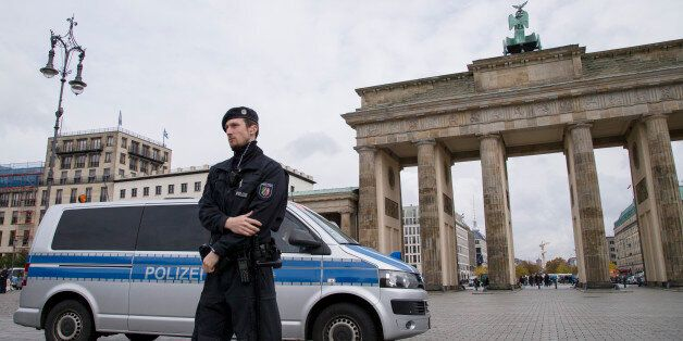 A policemen and plice car is pictured in front of Brandenburg Gate in Berlin, Germany on October 16,...