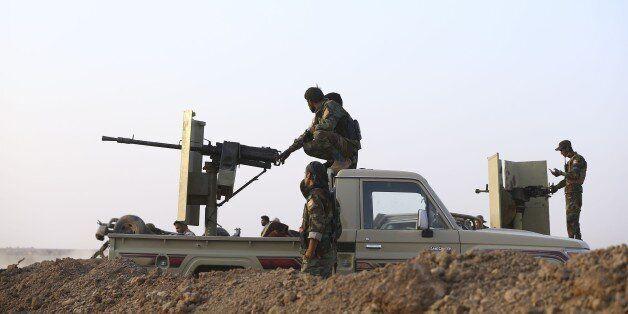 MOSUL, IRAQ - OCTOBER 23: Iraqi Kurdish Regional Government's peshmerga forces take positions as they...