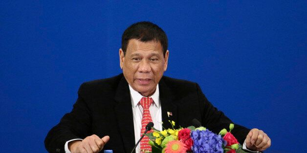 Philippine President Rodrigo Duterte delivers a speech during the Philippines-China Trade and Investment...