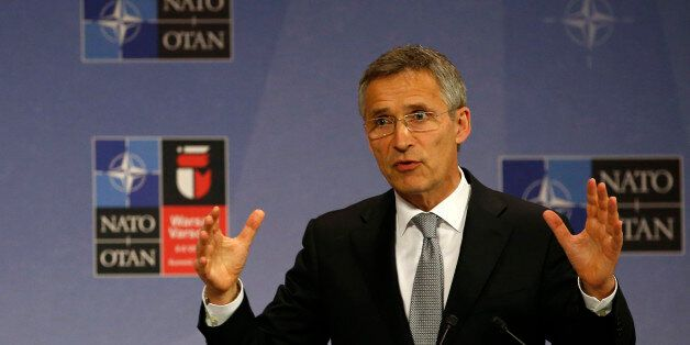 NATO Secretary General Jens Stoltenberg speaks during a news conference at NATO headquarters in Brussels,...