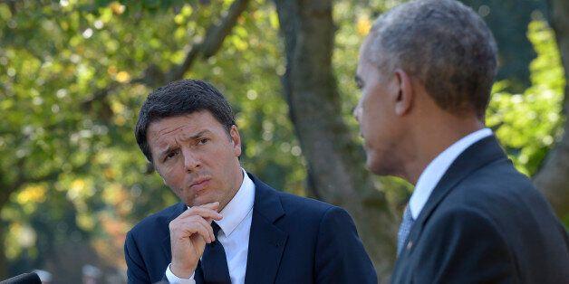 Italian Prime Minister Matteo Renzi listens as President Barack Obama speaks during their joint news...