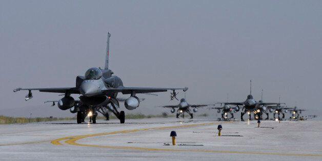 A squadron of Turkish Air Force F-16 Block 50+ aircraft taxiing on the runway at Konya Air Base,