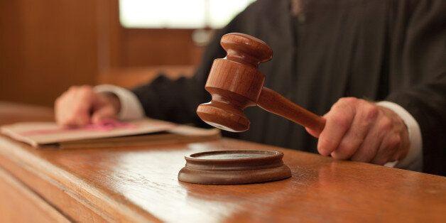 Judge holding gavel in
