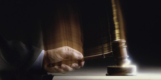 Close-up of a judge handing down a