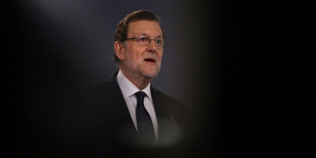 Spain's acting Prime Minister Mariano Rajoy speaks during a news conference at Moncloa Palace in Madrid,...