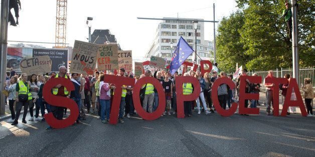 FILE - In this Tuesday, Sept. 20, 2016 file photo, protestors hold an Anti-CETA banner during a demonstration...