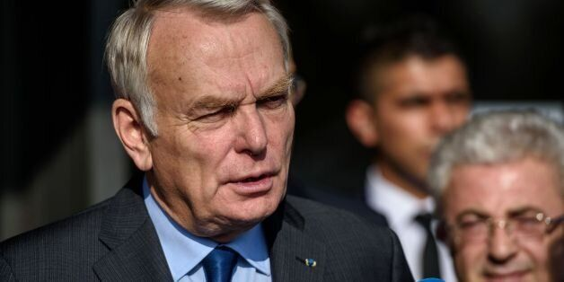 French Minister for Foreign Affairs Jean-Marc Ayrault speaks to media after his arrival at the airport...