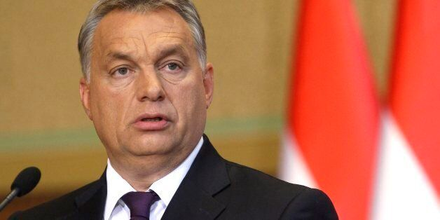 Hungarian Prime Minister Viktor Orban speaks during a press conference concerning the referendum held...