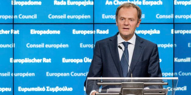 European Council President Donald Tusk addresses the media after the first day of an EU summit in Brussels...