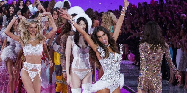 Models celebrate after presenting creations from the 2015 Victoria's Secret Fashion Show in New York,...