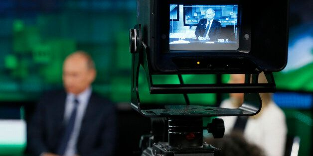 FILE - In this Tuesday, June 11, 2013 file photo, Russian President Vladimir Putin is shown on the screen...