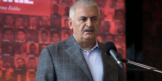 Turkish Prime Minister Binali Yildirim speaks in Istanbul, Sunday, Oct. 9, 2016. Kurdish militants detonated...