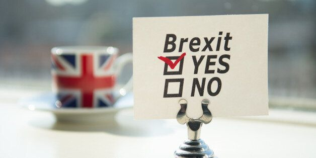 coffee with union jack and an brexit referendum note with yes