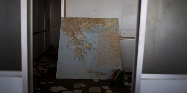 In this photo taken on Tuesday, May 19, 2015, a map of Greece lies inside what used to be airline offices...