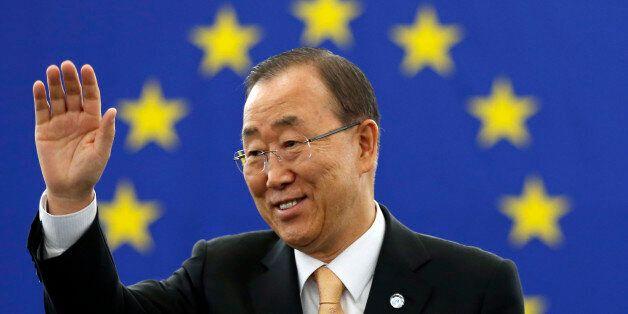UN Secretary General Ban Ki-moon waves before addressing members of the European Parliament in Strasbourg,...
