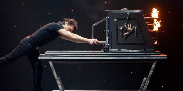 Illusionist Gaetano Riggiano performs his trick at Rome's Olympic theatre, Monday Jan. 26, 2009. Italy's...