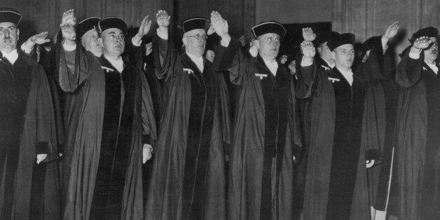 (GERMANY OUT) GERMANY: JUDGES, 1936. /nCeremony in criminal court at Berlin with judges displaying their...