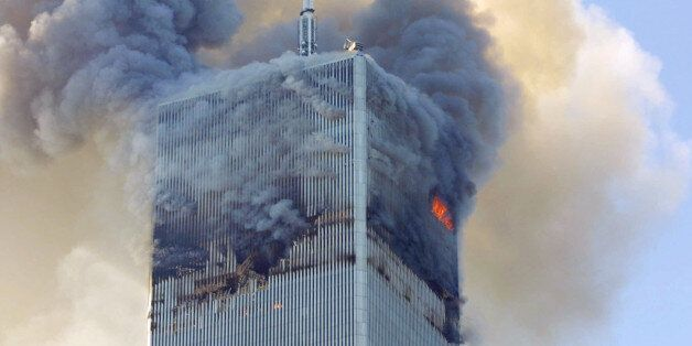 FILE- In this Tuesday, Sept. 11, 2001 file photo, fire and smoke billows from the north tower of New...