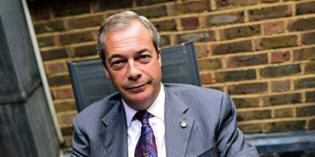 Former UKIP leader Nigel Farage poses for a picture during an interview with Reuters at his Westminster...