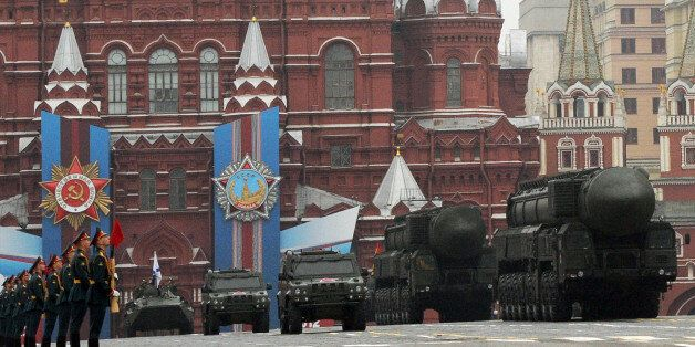 A column of Russia's Topol intercontinental ballistic missile launchers rolls at the Red Square in Moscow,...