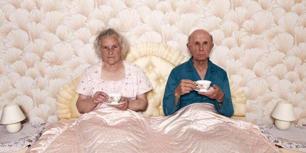 senior married pensioners aged two people dated retro sharing patterned chintz Caucasian wallpaper bedtime...