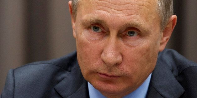 Russian President Vladimir Putin listens to German Vice Chancellor and Economy Minister Sigmar Gabriel...
