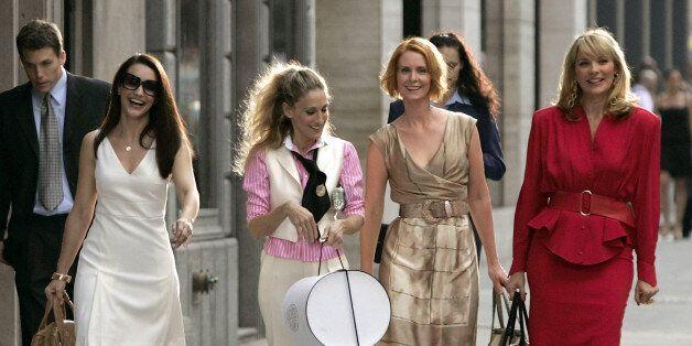 NEW YORK - SEPTEMBER 21: Actresses Kristin Davis as 'Charlotte,' Sarah Jessica Parker as 'Carrie Bradshaw,'...
