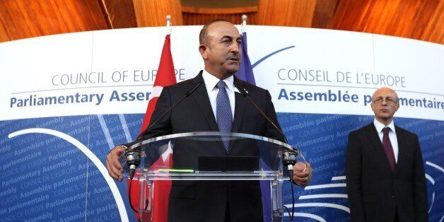 STRASBOURG, FRANCE - OCTOBER 12: Turkish Foreign Minister Mevlut Cavusoglu (C) delivers a speech with...