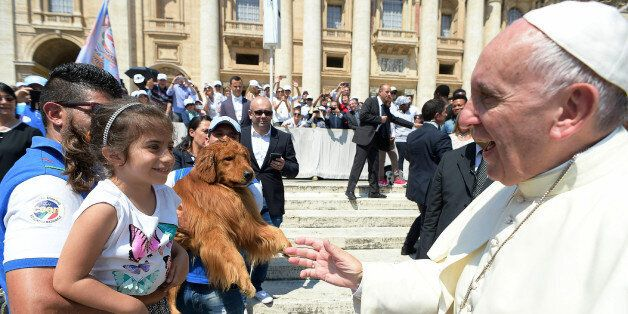 Pope Francis greets members of a marine search and rescue dogs school at the end of his weekly general...
