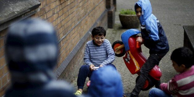 Migrant children from Syria play in front of a Protestant church in Oberhausen, Germany, November 19,...