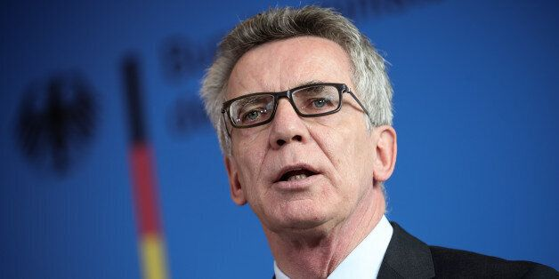 German Interior Minister Thomas de Maiziere delivers a statement in Berlin, Tuesday Sept. 13, 2016. Germany's...