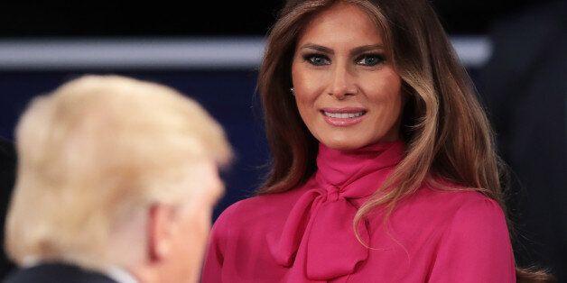 ST LOUIS, MO - OCTOBER 09: Melania Trump (R) greets her husband Republican presidential nominee Donald...