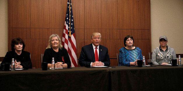 Republican presidential nominee Donald Trump sits with (from R-L) Paula Jones, Kathy Shelton, Juanita...