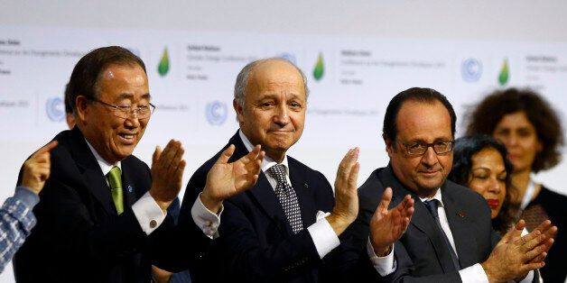 French President Francois Hollande, right, French Foreign Minister and president of the COP21 Laurent...