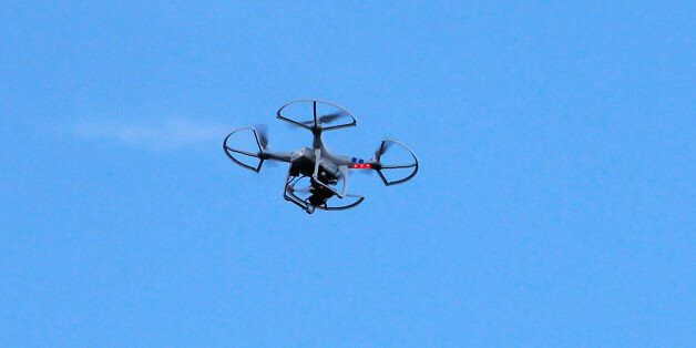 A drone is seen next to a television antenna above the family home of slain U.S. journalist Steven Sotloff...