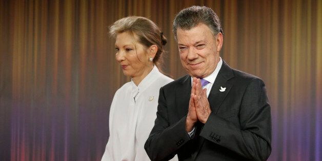 Colombia's President Juan Manuel Santos, right, arrives with his wife Maria Clemencia Rodirguez for a...