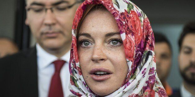 GAZIANTEP, TURKEY - OCTOBER 08: American actress Lindsay Lohan (C) speaks to press members with wearing...