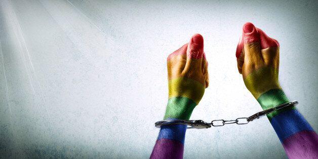 handcuffed hands - discrimination