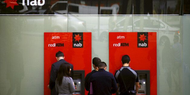 Customers withdraw money from National Australia Bank (NAB) Automatic Teller Machines (ATMs) in central...