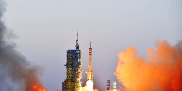 JIUQUAN, CHINA - OCTOBER 17: The Long March-2F rocket carrying Shenzhou 11 manned spacecraft blasts off...