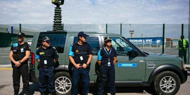 Romanian Border police officers look on during an inauguration ceremony of the new European Border and...