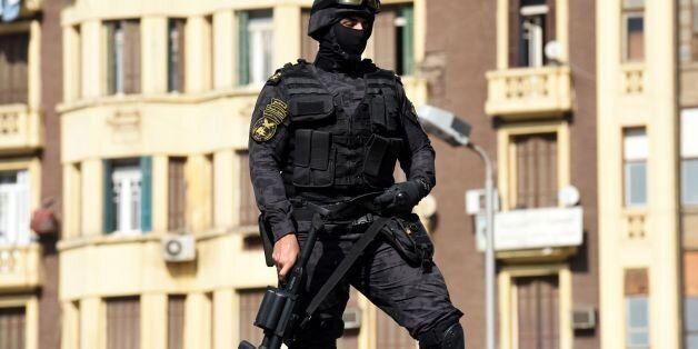 An Egyptian riot policeman stands guard on top of a vehicle protesters during a demonstration against...