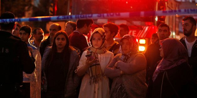 People watch behind a police line at the scene of a blast in Istanbul, Thursday, Oct. 6, 2016. A bomb...