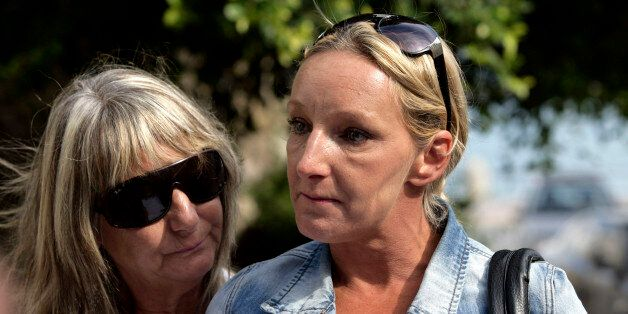 KOS, GREECE - OCTOBER 22: Kerry Grist (C) and her mother Christine Needham make a statement to the media...